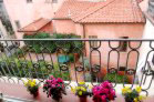 Bright sun room (covered terrace) overlooking rooftops, church towers, neighbors' gardens and Piazza Sant'Anastasio